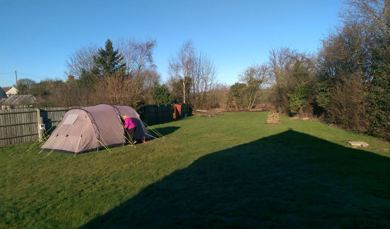 Pitching Outwell tent in the garden