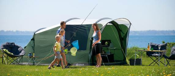 Family camping in select tent