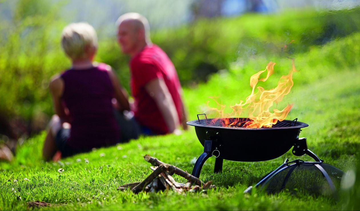 Couple sitting in front of a Cazal Fire Pit