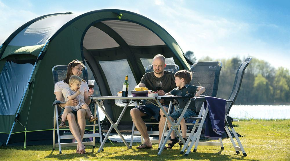 Family eating in front of their Outwell Phoenix Awning